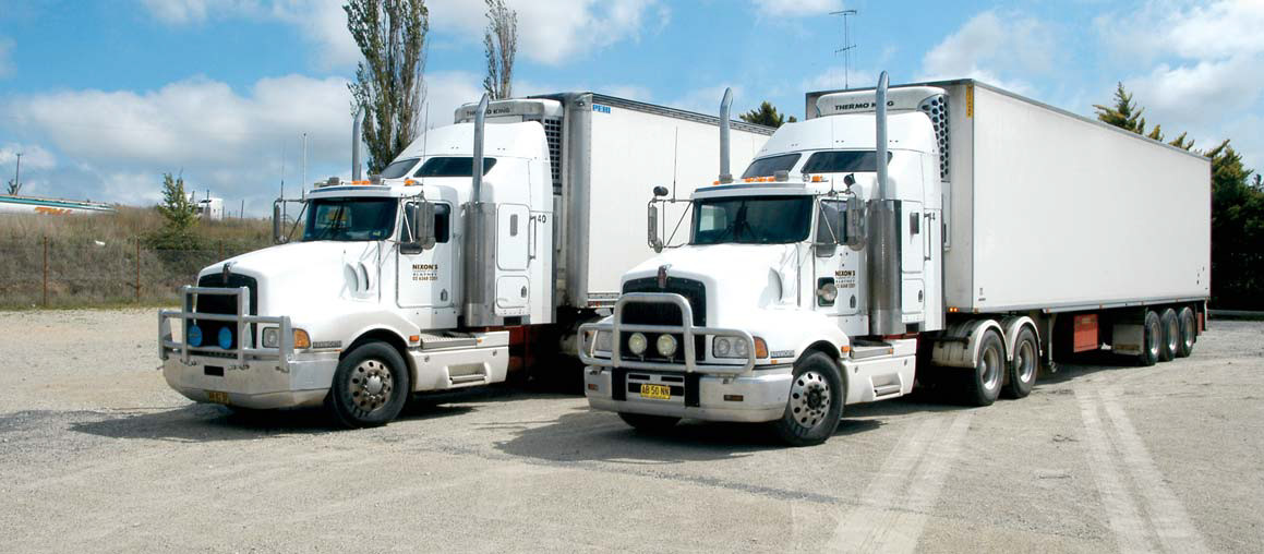 Two of Nixon's Transport Kenworth T404 trucks.